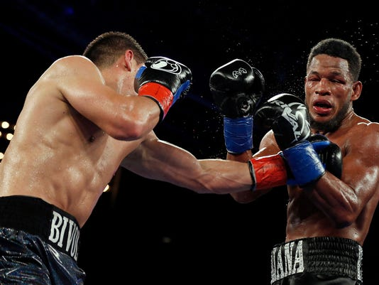 Dmitry Bivol, of Russia, punches Sullivan Barrera, of Cuba, during the eighth round of a WBA light heavyweight title boxing match Saturday, March 3, 2018, in New York. (AP Photo/Adam Hunger)