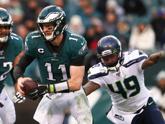 PHILADELPHIA, PA - NOVEMBER 24: Carson Wentz #11 of the Philadelphia Eagles scrambles against Shaquem Griffin #49 of the Seattle Seahawks in the fourth quarter at Lincoln Financial Field on November 24, 2019 in Philadelphia, Pennsylvania. The Seahawks defeated the Eagles 17-9. (Photo by Mitchell Leff/Getty Images)