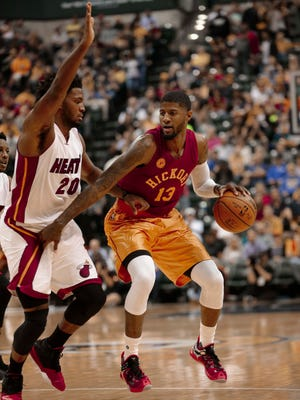 Indiana Pacers forward Paul George (13) in action during the second half of an NBA basketball game in Indianapolis, Friday, Nov. 6, 2015. The Pacers won 90-87. (AP Photo/AJ Mast)