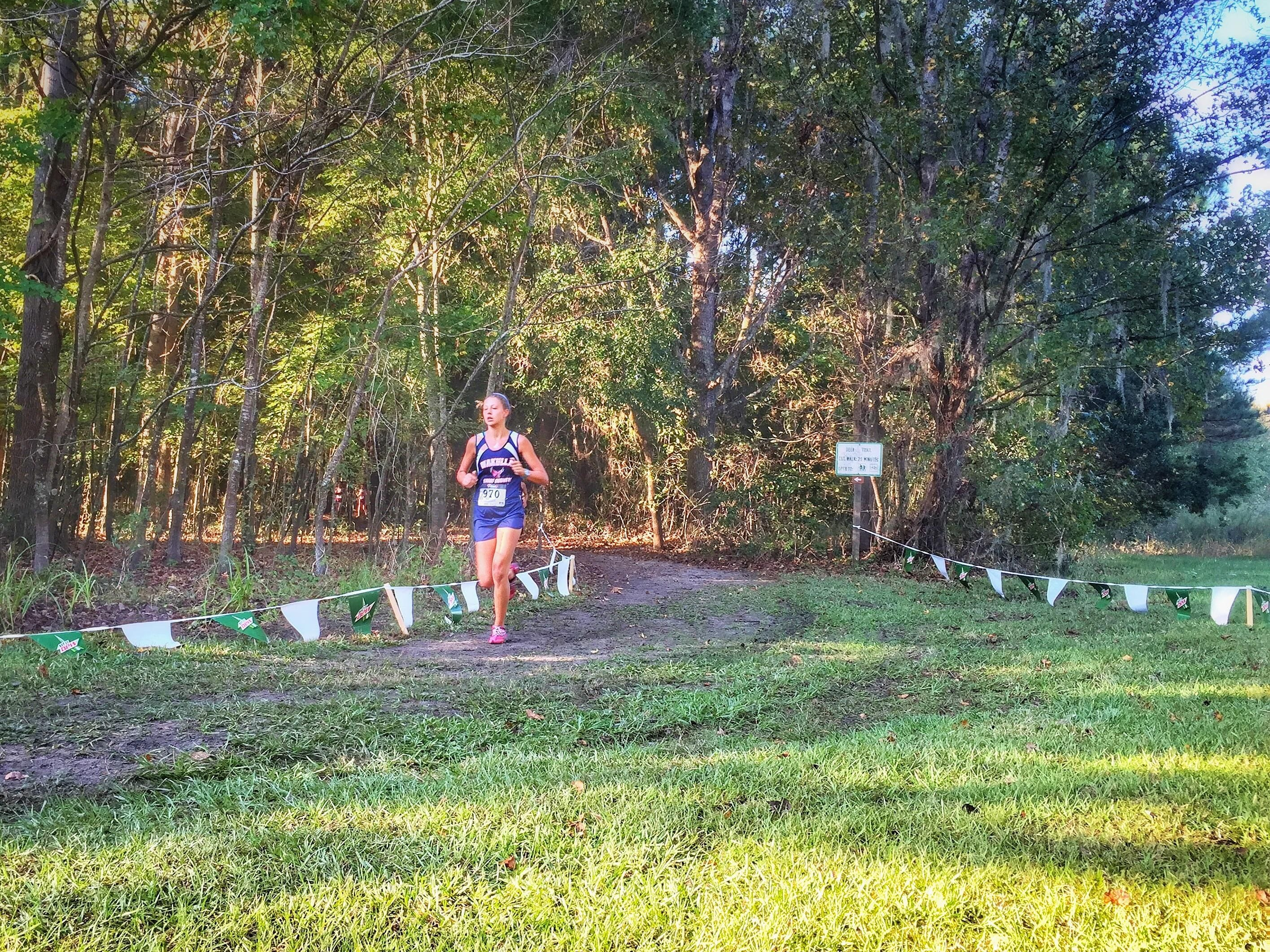 Wakulla junior Haleigh Martin exits woods during the Region 1-2A meet in Lake City. Martin was sixth, getting her into the state meet.