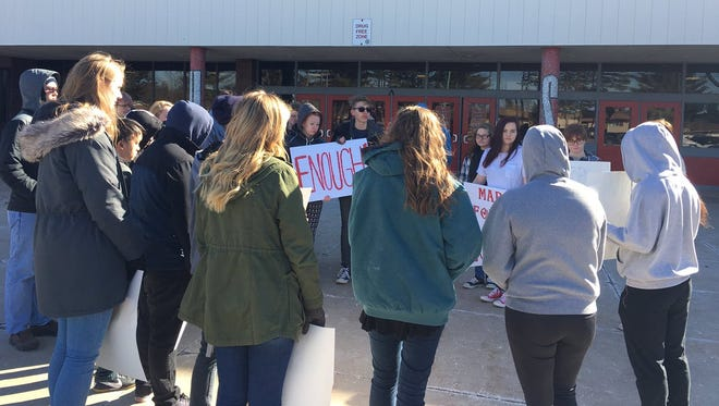 Lincoln High School students read the names of the victims of the Feb. 14 Parkland, Florida, high school shooting during a walkout on March 14, 2018, in Wisconsin Rapids. A moment of silence followed.