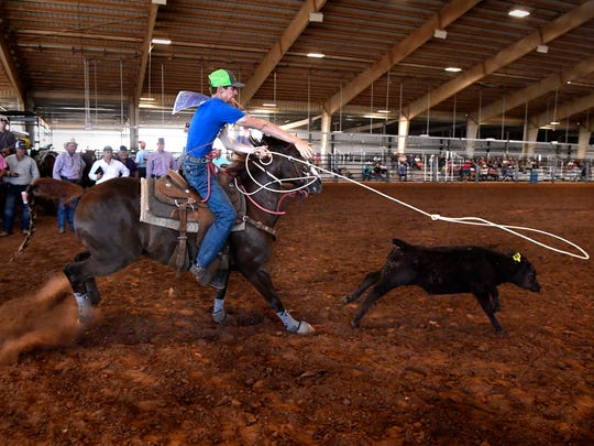 Colton Greene of Rock Springs competes in High Stakes Calf Roping last year in the Outdoor Arena at the Taylor County Expo Center. The Texas High School Rodeo Association Finals will be in Abilene through 2022.
