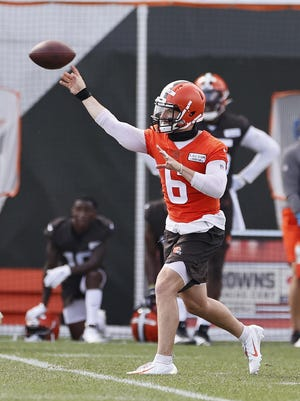 Browns quarterback Baker Mayfield throws a pass during practice Friday, Aug. 14, 2020, in Berea.