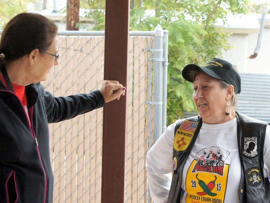 "At right, Dorothy ""China"" Roberts chats with an American Legion Bataan Post 4 volunteer prior to Saturday's Forgotten Veterans Bike Run."