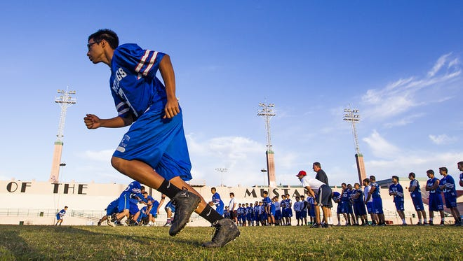 North High School football player Tommy Montero runs a route during practice at North High School. Enthusiasm for football is picking up at the central Phoenix high school.