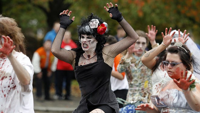 """Kelli Swanson Jaecks (center) participates in last year's Thrill the World, a simultaneous worldwide dance to Michael Jackson's """"Thriller."""" The event kicks off this year's Halloweek, a weeklong series of Halloween events from October 24-31 in Salem and Keizer."""