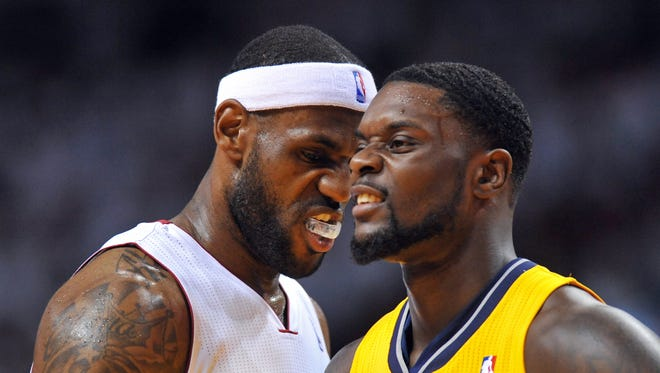 May 30, 2014; Miami, FL, USA; Miami Heat forward LeBron James (6) stands next to Indiana Pacers guard Lance Stephenson (1) in game six of the Eastern Conference Finals of the 2014 NBA Playoffs at American Airlines Arena.