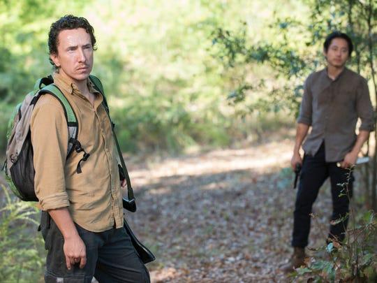 "Michael Traynor as Nicholas and Steven Yeun as Glenn Rhee in ""The Walking Dead."""