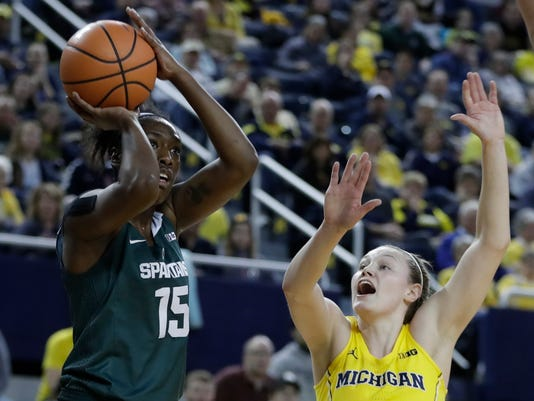 Michigan State forward Victoria Gaines (15) shoots as Michigan guard Nicole Munger (10) closes in during the first half of an NCAA college basketball game, Tuesday, Jan. 23,2018, in Ann Arbor, Mich. (AP Photo/Carlos Osorio)