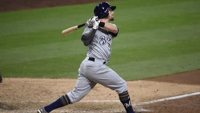 Eric Sogard hits a solo home run during the top of the 10th inning to give the Brewers a 5-4 lead.