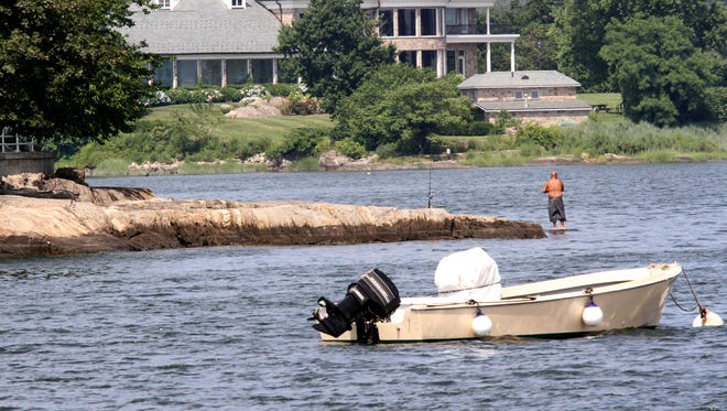 A fisherman in Long Island Sound off the shore of New Rochelle July 7, 2011.