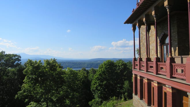 The Hudson River can be seen beyond the treetops surrounding Olana, the home of artist Frederic Edwin Church, in Greenport, N.Y.