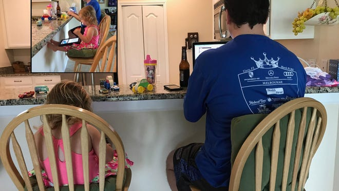 While Daddy Duty columnist Tim Walters does some work at his mom's house on a recent Sunday, Isabella mimics him on her tablet.