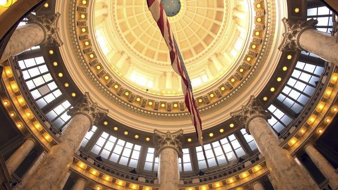 In this Feb. 26, 2018, file photo, an American flag hangs inside the rotunda of the Idaho Capitol in Boise, Idaho.