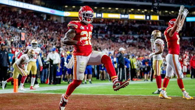 Kansas City's #26 Damien Williams scores a touchdown during the fourth quarter of Super Bowl LIV at Hard Rock Stadium in Miami Gardens, Feb. 2, 2020.