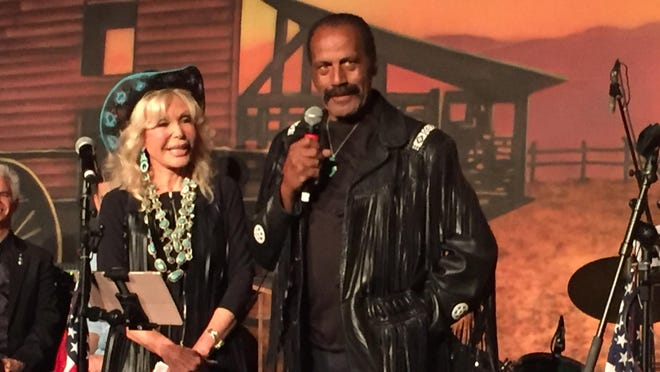 Fred Williamson, seen here next to Trumpettes founder Toni Holt Kramer at the 2019 event, was at Saturday night's celebration.