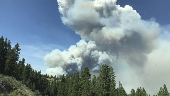 Smoke from the Hog Fire is seen from Highway 36 west of Susanville on Sunday. Mandatory evacuations are in effect for the Hog Fire, which has grown to 9 square miles.
