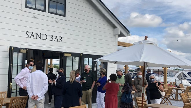 Guests at a preview event Tuesday before Wednesday's public opening gather at the Sand Bar at The Lake House on Canandaigua.
