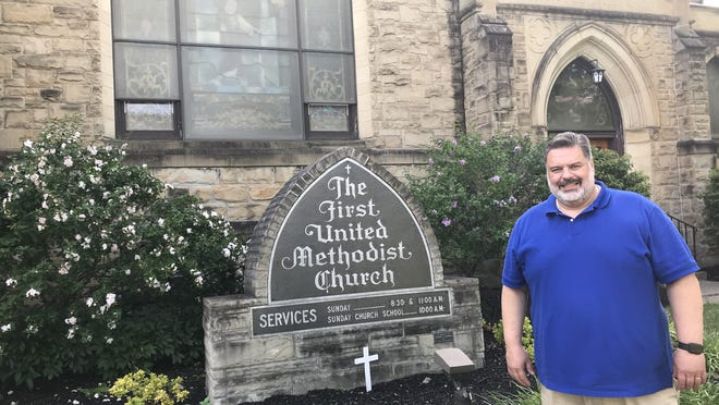 """The Rev. Bill Allen stands outside the First United Methodist Church of Canandaigua at 100 N. Main St. """"I'm really glad to be here. The congregation has been super welcoming,"""" he said."""