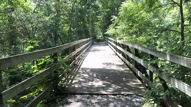 We took this 96-foot long bridge over Flint Creek to mark trail number 6 on the Ontario Pathways Rail Trail.