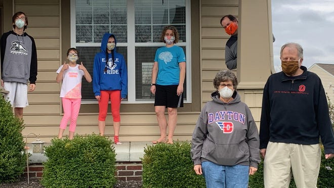 The Columbus Historical Society board of trustees president Mike Frush and his family wear masks and practice social distancing during an Easter visit. This photo is part of the growing collection of coronavirus-related material being collected by the society.