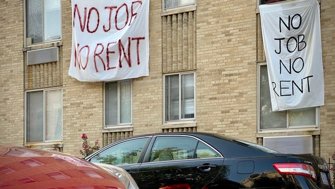 Banners against renters eviction are displayed on a controlled rent building in Washington, D.C., on August 9.