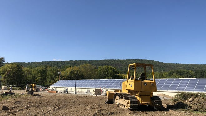 The new sewage treatment plant nearing completion in the village of Naples is seen Wednesday.
