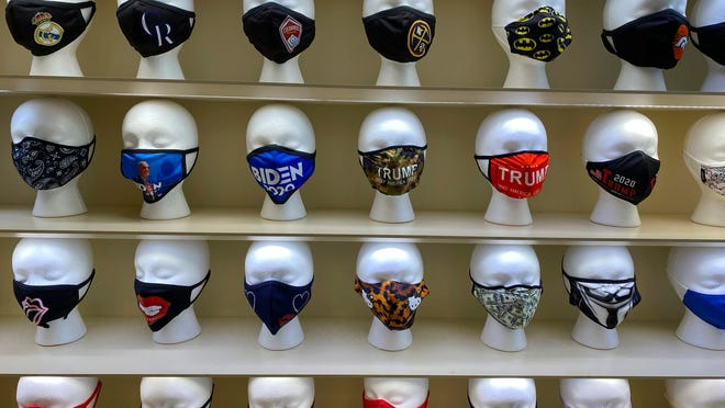 Face masks are displayed for sale at a COVID-19 Essentials store in Park Meadows Mall, outside Denver, in Lone Tree, Colo.