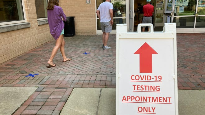 More than 1 in 3 Americans say they know someone who has been sick from coronavirus, survey shows. Here, Montgomery County, Maryland, residents, wait in line to be tested for the COVID-19 coronavirus at a county testing site in Chevy Chase, on July 8, 2020.