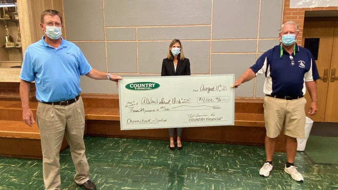 AlWood School District received a $4,000 donation from Todd Greenman, at left, Country Financial agent. Also in the photo at back is Melissa Brown, AlWood School Board president, and at right, Shannon Bumann, AlWood superintendent.