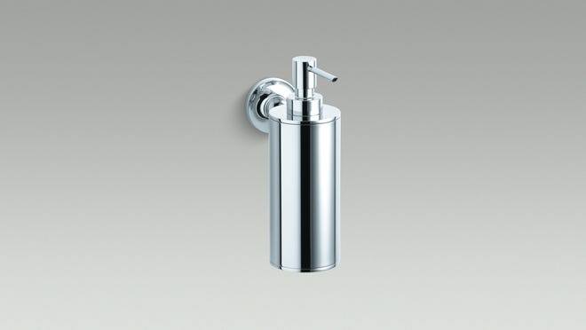 Add a wall-mounted soap, cream or sanitizer dispenser just above a wall-hung sink as a space-saving solution.