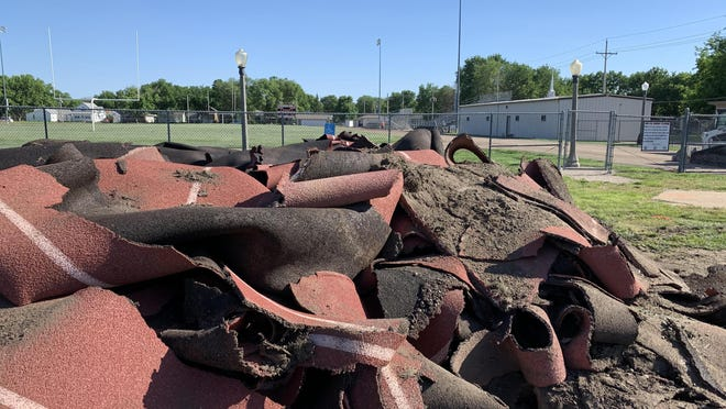 Remains of the all-weather track at Cowboy Stadium in Abilene sits in a pile on the north end of the complex this past Friday. The stadium is in the midst of a $4 million-plus renovation.