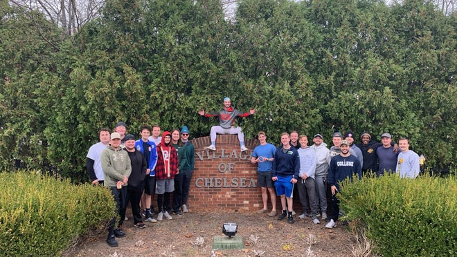 """Members of Adrian College's fraternity Theta-Omicron Chapter's of Tau Kappa Epsilon, pose for a photo Sunday, Oct. 25 in Chelsea, after embarking from Adrian that same day in their second annual """"St. Jude Sprint"""" fundraising event. The fundraiser involved the fraternity members running from Adrian to Chelsea -- a total of 30 miles -- while money raised from the event benefits the St. Jude's Children Research Hospital."""
