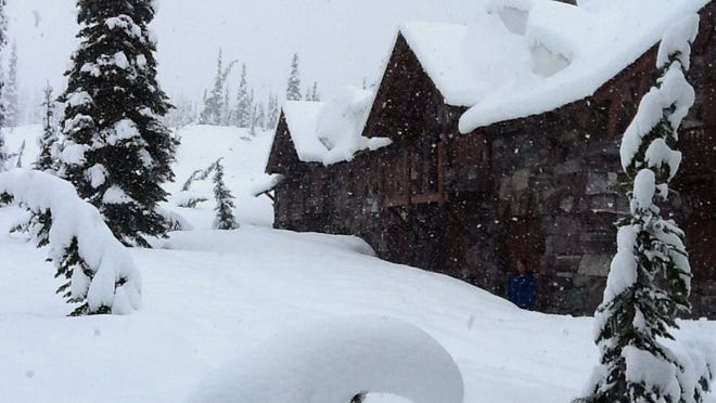 A photo provided by Glacier National Park shows the Sperry Chalet in Glacier National Park on Wednesday. National Weather Service employees at Sperry Chalet report 14-16 inches of snow since Tuesday morning. Tourists hunkered down in lodges, snow plowing crews stood down, and park officials were preparing for possible employee evacuations from the St. Mary area.