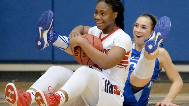 MRA's Tatyana Lofton (front) and Trista Magee of PCS share a light moment on the floor in the first half on Saturday, February 14, 2015, during the MAIS basketball playoffs at Jackson Academy in Jackson, Miss. Lofton was called for an offensive foul on the play.