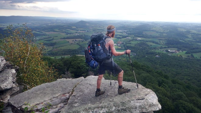 Portland native Joseph Calloway, 29, conquers a mountaintop while climbing the Appalachian Trail in 2014.