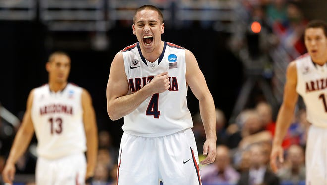 Arizona Wildcats guard T.J. McConnell (4) gets himself pumped up in the first half during the NCAA Sweet 16 game at the Honda Center in Anaheim.