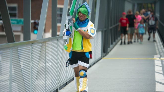 Tyler Ruth of Knoxville, dressed as Arcade Riven from the League of Legend video game walks towards the Fanboy Expo in the Knoxville Convention Center Saturday, June 24, 2017.