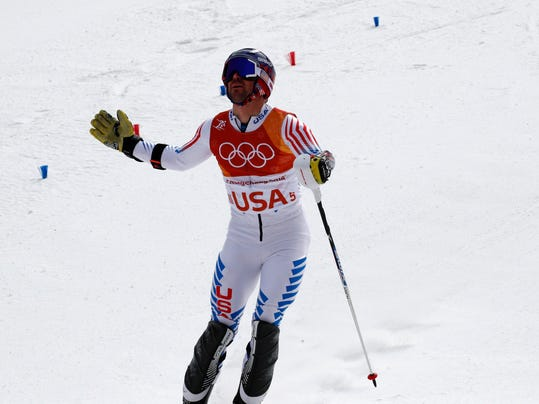 United States' David Chodounsky reacts after racing Britain's Laurie Taylor in the alpine team event at the 2018 Winter Olympics in Pyeongchang, South Korea, Saturday, Feb. 24, 2018. (AP Photo/Christophe Ena)