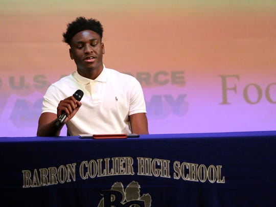 Barron Collier football player Jacine Olibrice thanks those who have helped him along the way prior to signing his letter of intent to play for the Air Force Academy during a signing day ceremony at Barron Collier High School on Wednesday, Feb. 1, 2017.