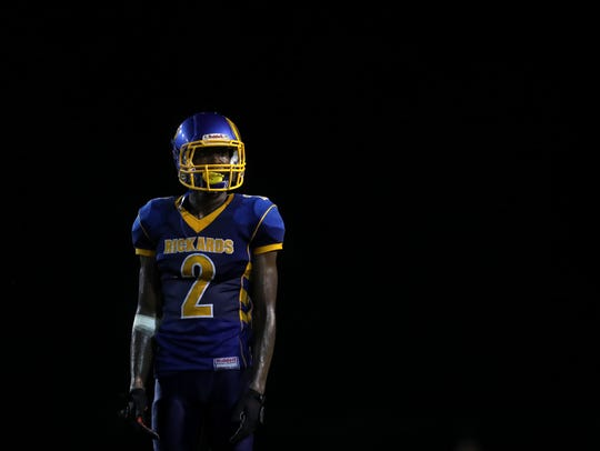 Rickards' Javon Peterson looks to the sidelines for