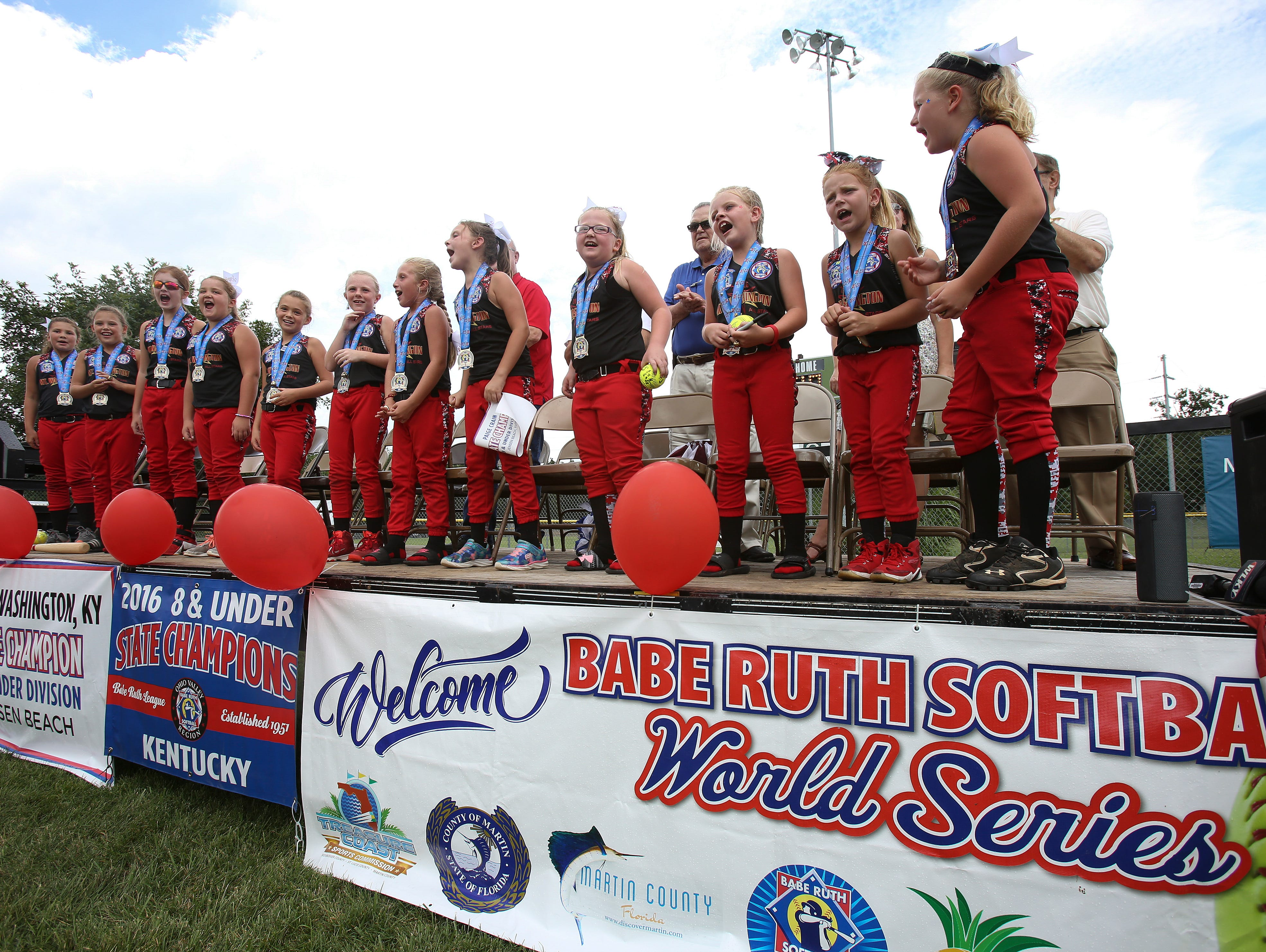 The Mount Washington All Stars 8 and under softball team sang a team chant during a pep rally to celebrate their state championship in the Babe Ruth Softball World Series. Aug. 14, 2016