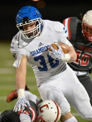 Cam Ryan (36) carries the ball for CC yardage.