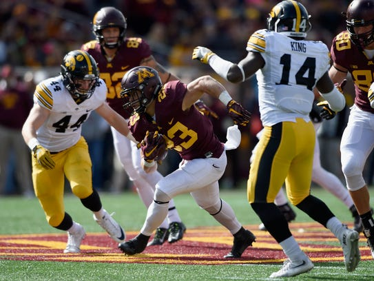 Iowa cornerback Desmond King, right, tracks Minnesota's