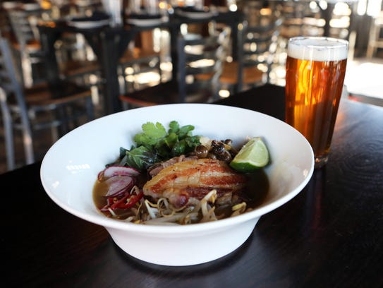 The braised pork belly pho with a Hubar DIPA at the