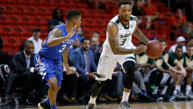 Nov 27, 2015; Miami, FL, USA; South Florida Bulls guard Roddy Peters (3) is pressured by Kentucky Wildcats guard Tyler Ulis (3) during the first half at American Airlines Arena.