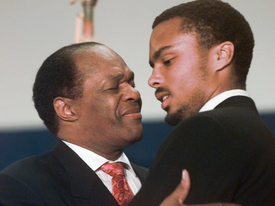 FILE - In this May 21, 1998 file photo, then-Washington Mayor Marion Barry hugs his son Christopher in Washington. Barry, who staged a comeback after a 1990 crack cocaine arrest, died early Sunday morning Nov. 23, 2014. He was 78. (AP Photo/Brian K. Diggs, File)