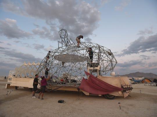Volunteers work on the Brain art car Burning Man 2014.