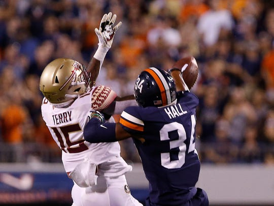 Sep 14, 2019; Charlottesville, VA, USA; Virginia Cavaliers cornerback Bryce Hall (34) breaks up a pass intended for Florida State Seminoles wide receiver Tamorrion Terry (15) in the first half at Scott Stadium. Mandatory Credit: Geoff Burke-USA TODAY Sports