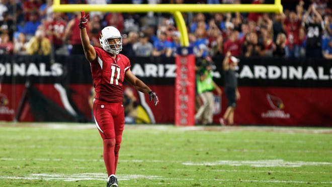 Arizona Cardinals' Larry Fitzgerald gestures his first down against the Detroit Lions on Sunday, Nov. 16, 2014 at University of Phoenix Stadium in Glendale.